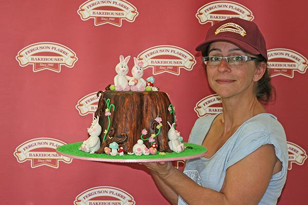 Maria Cerra, Decorating Room Manager shows off her first prize Easter novelty design cake